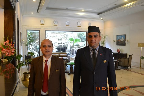 Grand Hotel Kathmandu: ashok in cap the helpful people.