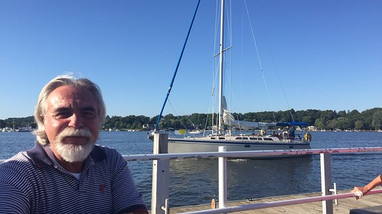 Sailboat just leaving Red Dock for a cruise through the Saugatuck channel and out to Lake Michig