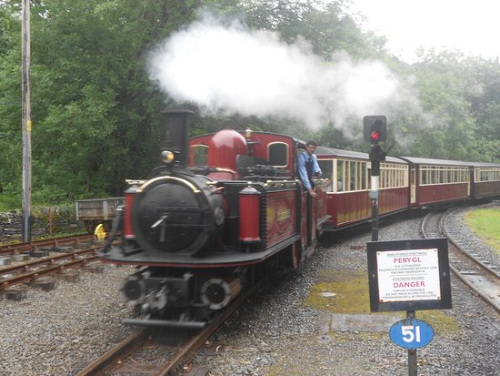 Ffestiniog & Welsh Highland Railways: Loco approaches a rather rainy Tan y Bwlch station, mid point on the railway.
