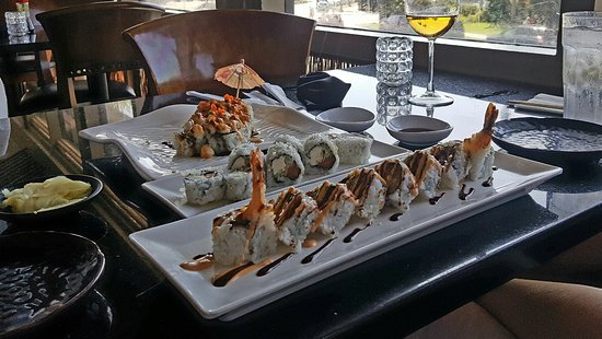 Yummy Sushi : Coronado roll has the umbrella coupled with a plum wine a Philadelphia roll and other specialty