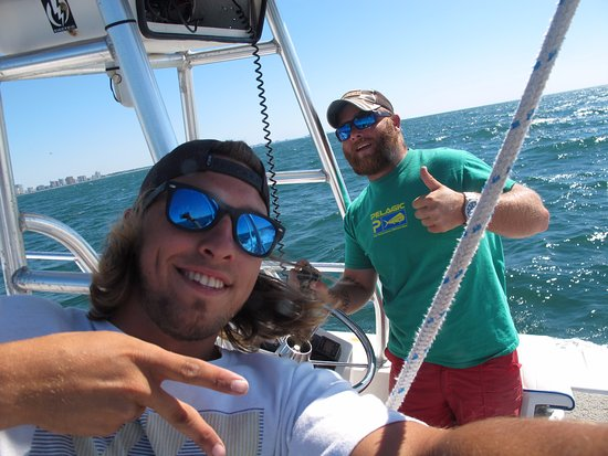 Ocean Watersports: Captain Red (red beard), and his helper.
