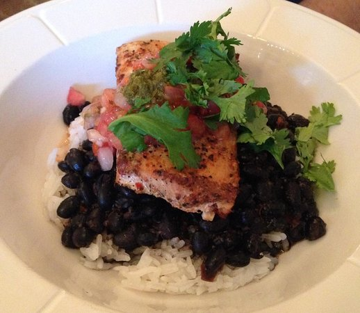 Dining Room: Blacked Mahi Mahi served with black beans and rice, topped with chimichurri and cilantro.