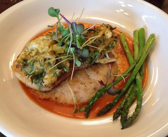 Jonesborough, TN: Grouper on a bed of yucca cake and tomato coulis.