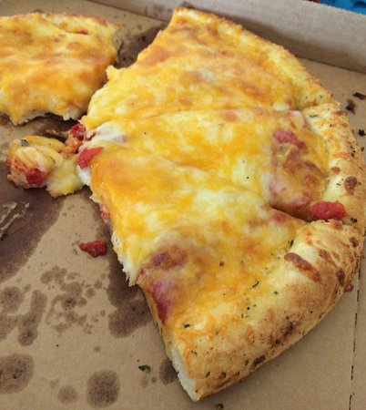 "Rawlins, WY: Buck's cheese pizza. The inspiration for the word ""gutbomb."" Cheese tasteless and piled high!"