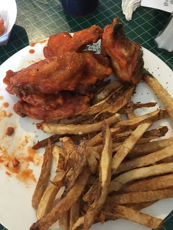 Angus & Ale: Hot wings & fresh cut fries and gator tail w/bacon as an appetizer