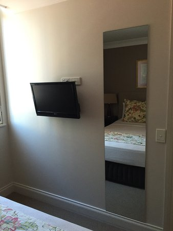 bedroom tv and mirror