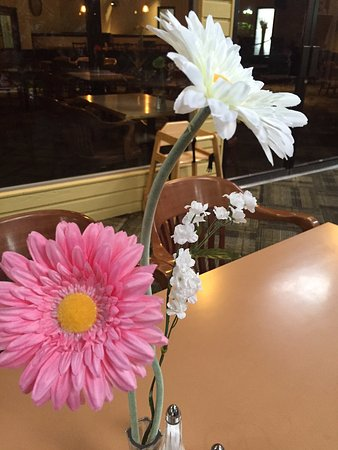 Gerber daisies on every table in the restaurant, Best Western Rainbow Country Inn, Chilliwack, B