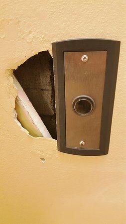 Gulf Breeze, FL: Hole in wall on 4th floor by elevator