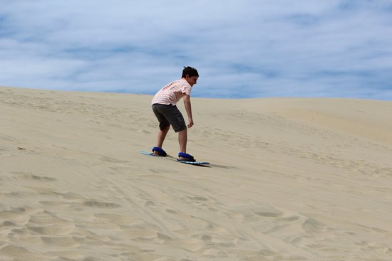 Florence, OR: Logan first run down the dune.