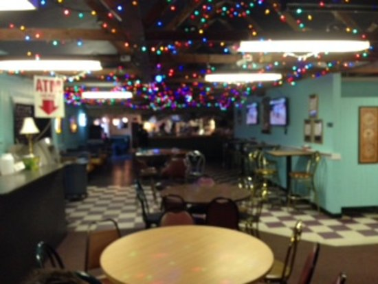 Hula's Bar and Grill : Inside of Hula's with bar at the end.