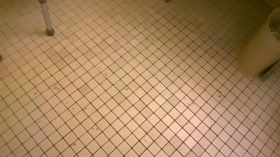 North Miami, FL: tar marks on bathroom floor