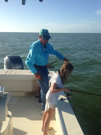 Fins N Grins Charter Fishing: Mikayla and Captain Mike