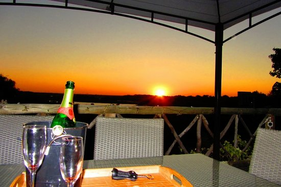 Katima Mulilo, Namibia: View from the upstairs terrace into the setting sun over the Okavango River