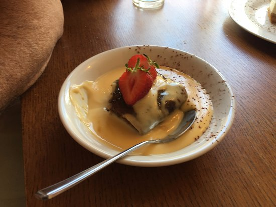 Bicester, UK: Sticky Toffee Pud - he couldn't wait for the photo