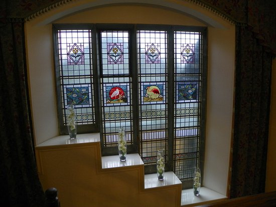 Sawrey, UK: stained glass window going up main stair case