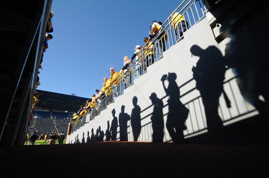 Ann Arbor, MI: Reflection of fans at the field level tunnel entrance at Michigan Stadium.