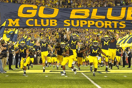 Ann Arbor, MI: Go Blue M Club Supports You banner. Michigan's first-ever night game.