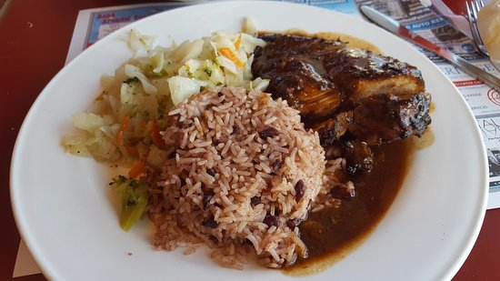Glen Burnie, MD: Dried out, too spicy to eat Mild Jerk Chicken, flavorless red beans and rice and Cabbage Mix