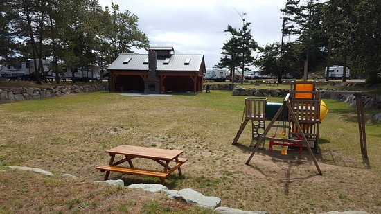 Comox, Canada: The covered gathering area is the large building in the rear of the play/open field area.