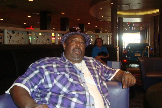 West Memphis, AR: My husband chilling and enjoying the atmosphere and music at Southland Park Gaming and Racing.