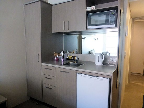 kitchenette in main room near the bed wardrobe on the left too small for two people for 15 nigh. Black Bedroom Furniture Sets. Home Design Ideas