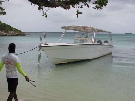 Creole Cruises Antigua: The boat and one of the crew.
