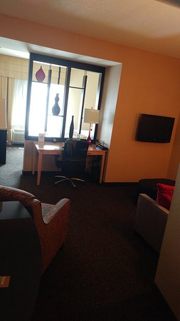 Noblesville, IN: The public area of the suite, with a couch, chair, and desk. The bed area is behind the wall.