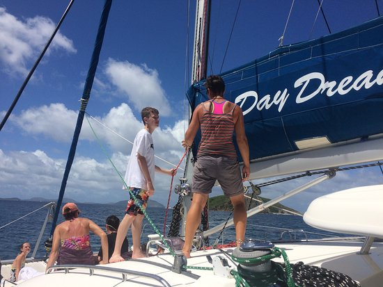 Road Town, Tortola: My son getting instruction on how to raise the main sail from Dee.