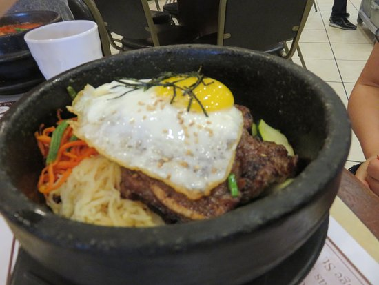 Nak Won: BBQ Beef short-ribs, fried egg and rice in stone pot