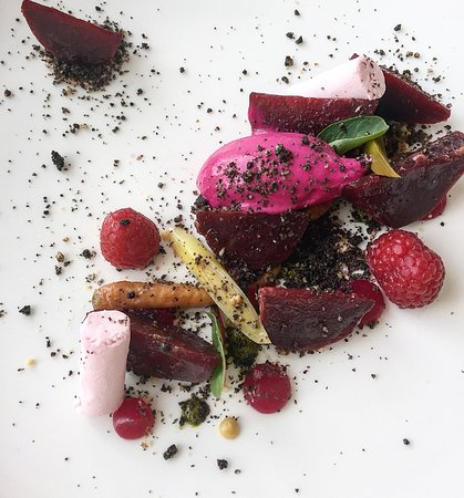 "Nesaea: Beetroot textures with vegetable roots, pickled raspberries, Mykonos ""Xynotiri"" cheese and kale"
