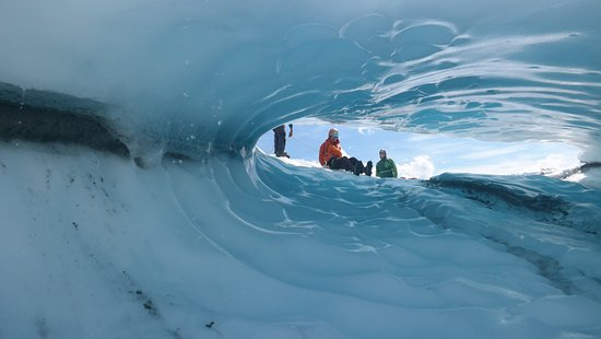 Mica Guides : Sliding down and ice cave.