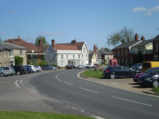 Cavendish, UK : The road into the village. Note the old phone box.