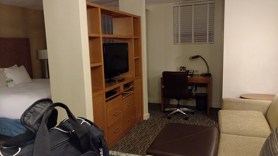 Dania Beach, FL: Living room, with tv that turns to bed, bathroom is next to bed.