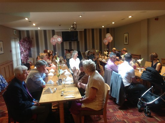 Par, UK: All friends and family enjoying the after Christening lunch.