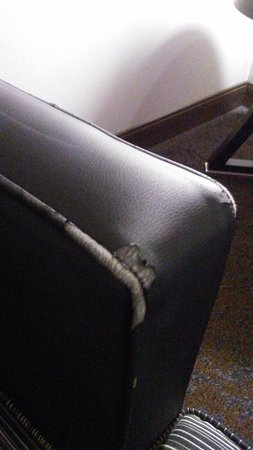 Hyatt Centric The Woodlands: Tattered and worn furniture in room