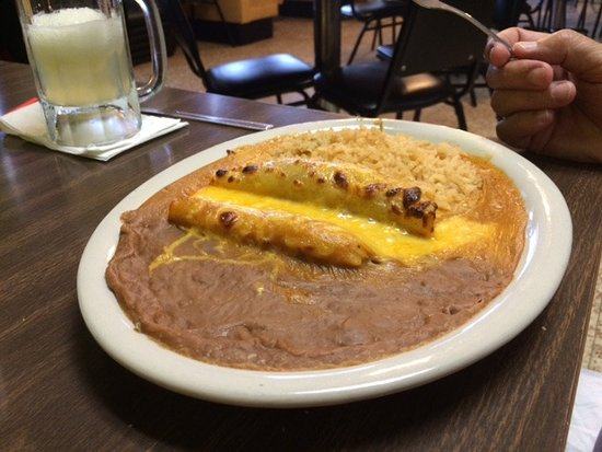 Humble, TX: Cheesy, hot tamale and enchilada. A perfect fiesta of flavors!