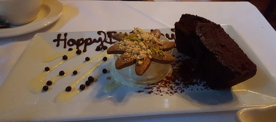 Elkridge, MD: Happy birthday written in chocolate, chocolate rum pound cake with coconut ice cream and cookie