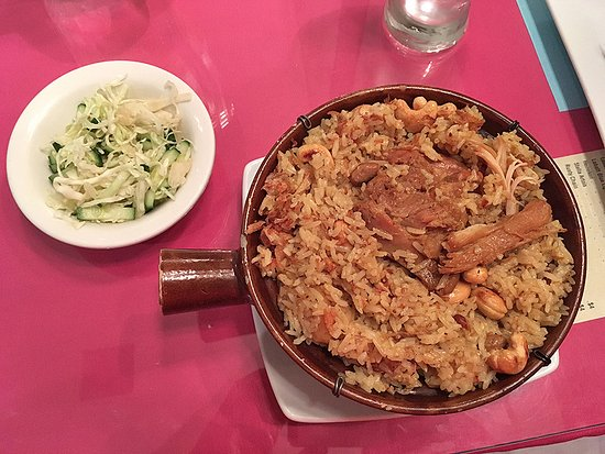 Depew, NY: Chicken and rice served in a pot, and served with a small cucumber salad.