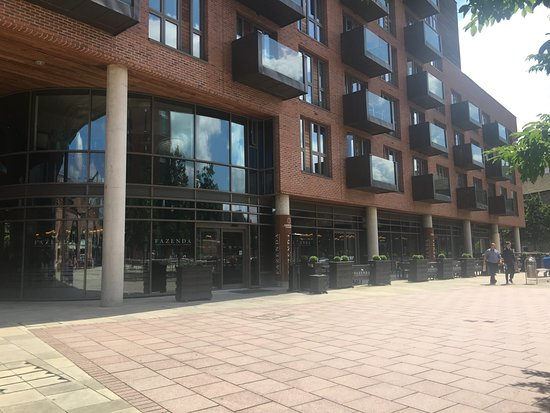 Fazenda Rodizio Bar & Grill: The front entrance is located near the area for parking barges.
