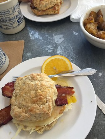 Biddeford, ME: The Biscuit Breakfast Sandwich w/thick cut bacon, a side of home fries and coffee