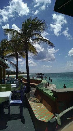 Compass Point Beach Resort: sitting in outdoor restaurant area with ocean view