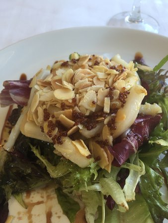 Senegue, Hiszpania: Squid & prawn salad served with almonds and a honey and mustard dressing.