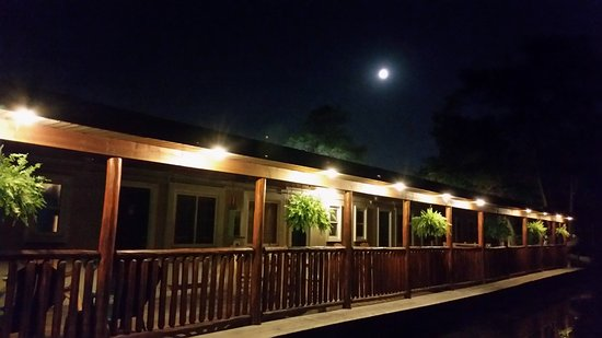 Clarkston, MI: View of the back porch at night.