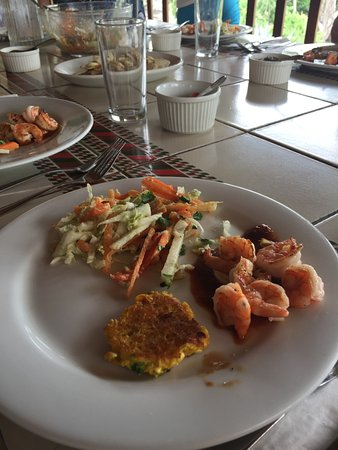 Playa Junquillal, Costa Rica: tropical salad, shrimp, ceviche, and corn cakes...and this was just the first course!
