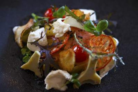 Lutterworth, UK: Heirloom tomato salad, goats'cheese, artichoke & basil