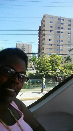 Picture of me enjoying the breeze. Picture of me saying bye to Turtle Beach Towers.
