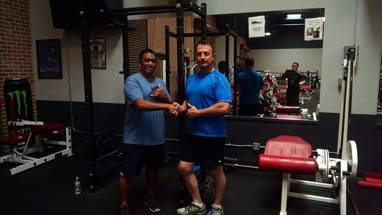The Gym Maui: THis was George, the sunday front desk guy. We are standing in front of a Rogue Power rack