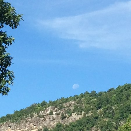 Minnewaska Lodge: Moon setting over the cliff in the morning, as seen from our deck (Rm 225)