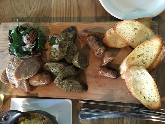 Munster, IN: Meat Plate. L to R. Pork and Mac sausage, ramp, beef and cheddar with black garlic mustard, brea