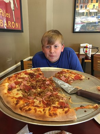 New York Pizzeria: Larger than we were expecting for 3. To go box and my son took care of it later!